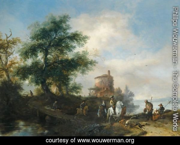 A River Landscape With A Gentleman And Lady Riding To The Chase, With A Pilgrim Asking For Alms In The Foreground, Other Members Of The Hunting Party Crossing A Wooden Bridge, A Tower Beyond